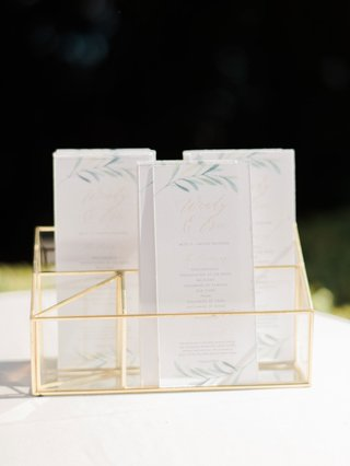 wedding-ceremony-gold-display-white-ceremony-program-greenery-flower-motif-muted