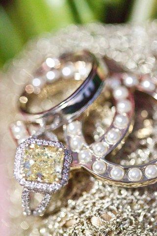 brides-engagment-ring-with-yellow-diamond-center-stone-halo-split-shank-grooms-platinum-ring