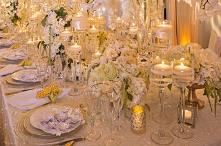 white-roses-and-orchids-glass-stands-for-floating-candles-textured-linens