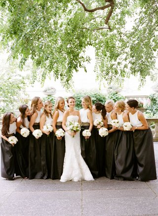 bride-in-vera-wang-gown-bridesmaids-in-long-black-skirts-white-silk-tops-leather-belts