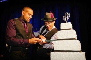 insanity-creator-shaun-t-cuts-wedding-cake-with-husband