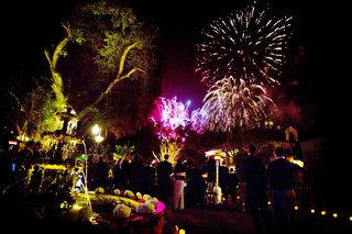 yellow-lighting-at-plantation-wedding-venue-with-surprise-firework-show-for-guests-at-reception