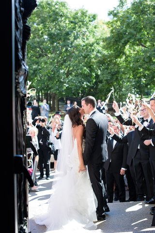 bride-in-monique-lhuillier-mermaid-wedding-dress-and-groom-in-gibeon-tolbert-kiss-outside-church
