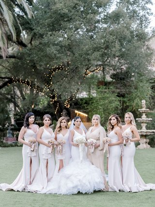 bride-in-ines-di-santo-wedding-dress-with-ruffles-bridesmaids-in-dress-me-pretty-neutral-tones