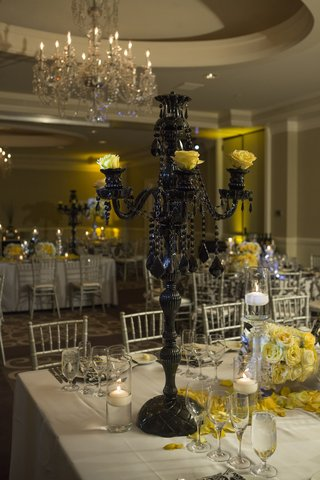 yellow-and-black-wedding-with-crystal-candelabra-painted-black
