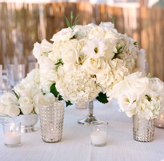 beachside-tented-wedding-reception-with-white-linens-hydrangeas-roses-lisianthus-in-silver-vessel