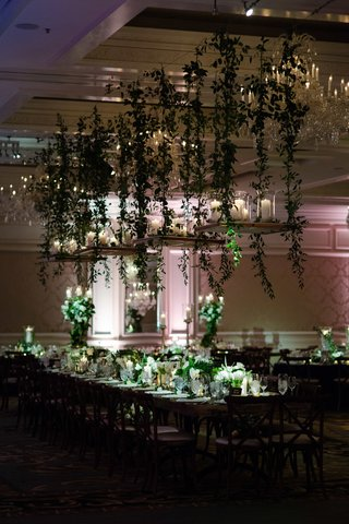 wedding-reception-dark-decor-green-white-flower-greenery-hanging-centerpiece-vines-candles