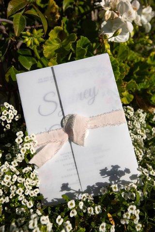 echosmith-singer-sydney-sierota-and-cameron-quiseng-wedding-ceremony-program-frayed-edge-ribbon-wrap