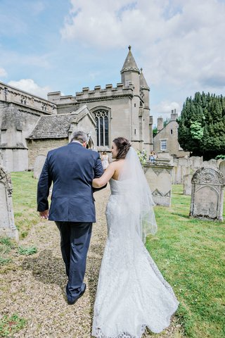 brides-father-walking-her-into-church-ceremony-england-english-british-wedding-st-andrews-uk
