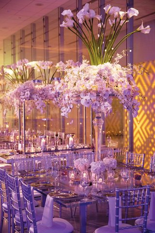 wedding reception in chicago white orchid and calla lily flowers silver chairs modern design