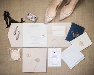 neutral-hue-invitation-suite-with-vow-books-and-wedding-jewelry