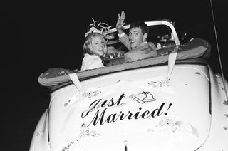black-and-white-photo-of-couple-in-vintage-automobile