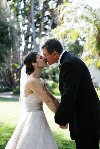 newlyweds-leaning-in-for-a-kiss