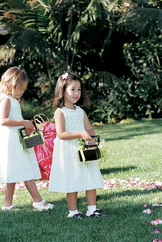 flower-girl-holding-basket-of-petals