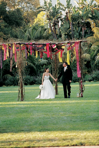 vibrant-colored-fabric-hanging-from-brown-canopy