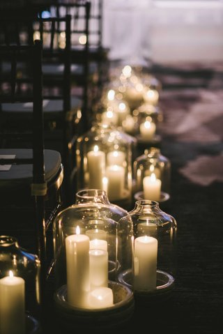 candles-in-large-vessels-line-the-aisle