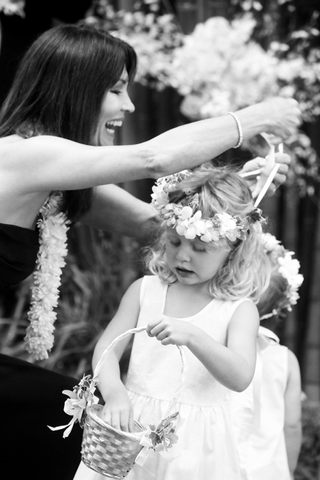 black-and-white-photo-of-woman-helping-flower-girl-with-flower-crown