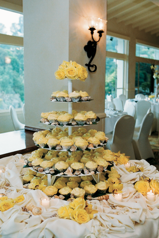 yellow-cupcakes-on-tiers-next-to-sea-shells