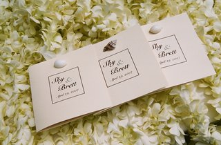neutral-wedding-program-with-real-sea-shells