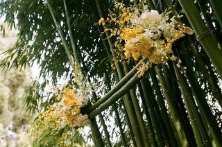 wedding-ceremony-altar-made-of-bamboo-and-yellow-roses
