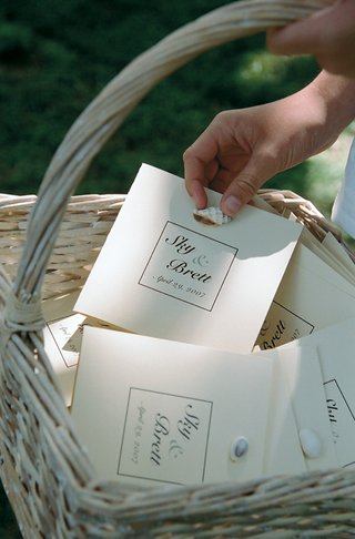 sea-shell-wedding-program-in-light-color-basket