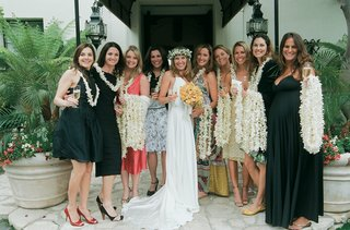 bride-with-female-friends-passing-out-white-orchid-leis