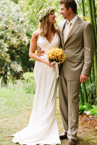 bride-in-white-dress-and-groom-in-tan-suit