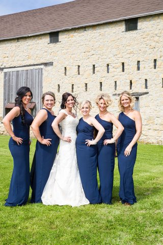 bride-with-bridesmaids-in-one-shoulder-long-blue-bridesmaid-dresses