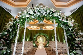 wedding-ceremony-indoor-hotel-ballroom-greenery-flower-arches-with-flower-cascading
