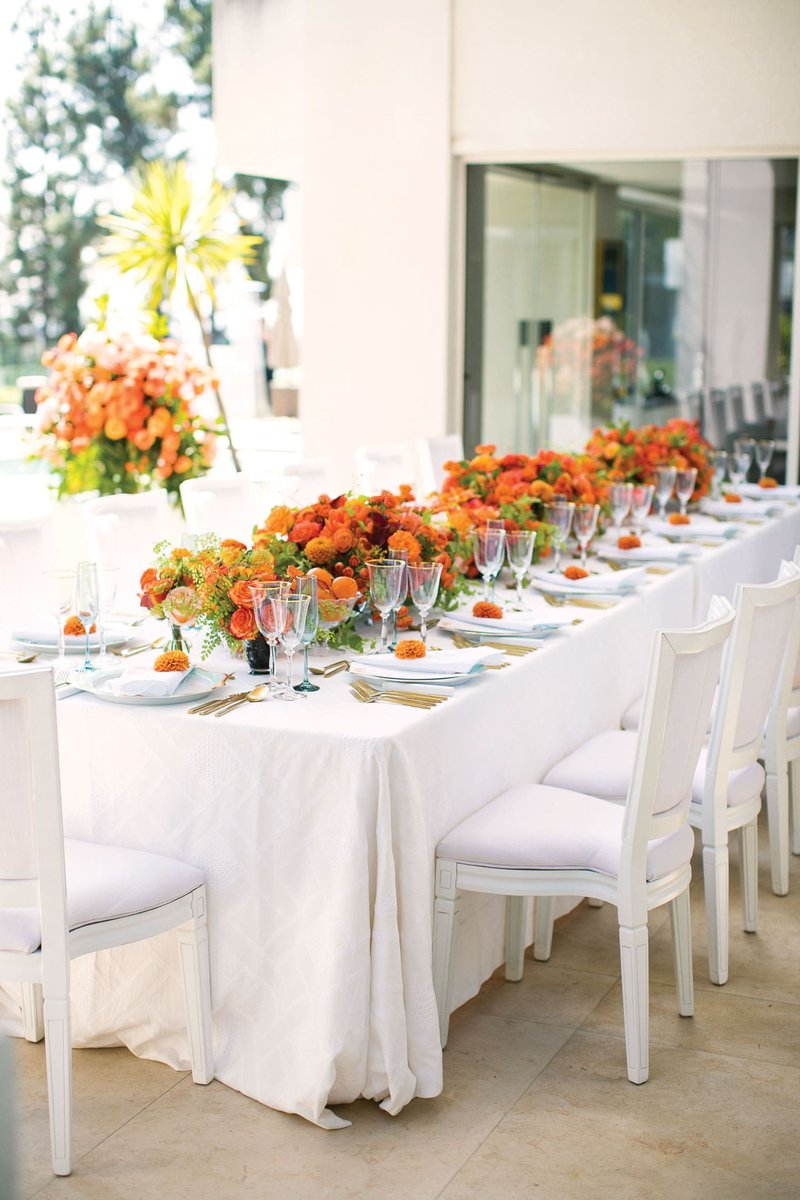 Outdoor Engagement Party with Orange Flowers