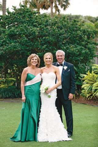 bride-in-marchesa-wedding-dress-with-parents-mother-of-the-bride-in-green-gown