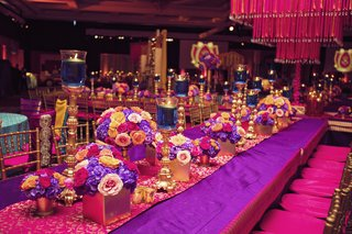 indian-wedding-sangeet-bright-colors-floating-candles-in-blue-water-purple-and-fuchsia-tablescape