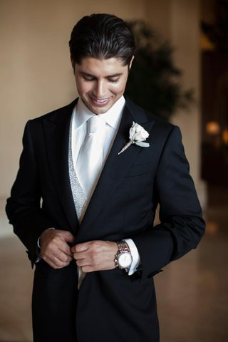groom-wearing-silver-vest-and-white-tie