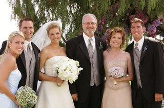 bride-with-her-parents-and-other-family-members