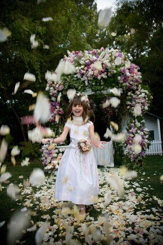 little-girl-throwing-flowers-at-backyard-ceremony