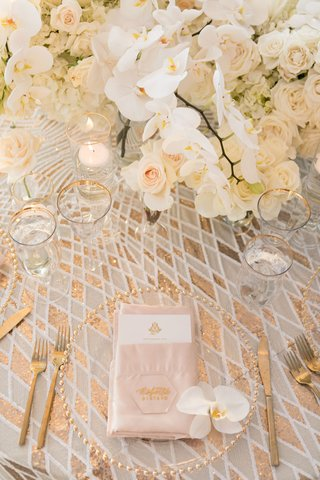 gold and white diamond print linens gold beaded charger and flatware orchid rose centerpieces