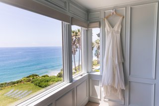 christos-wedding-dress-with-v-neck-waist-detail-layered-skirt-bridal-suite-with-ocean-view