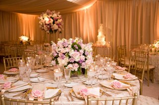 gold-chairs-and-glassware-under-ivory-tent