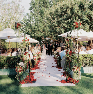 rosalynn-sumners-at-end-of-ceremony-aisle-under-trees