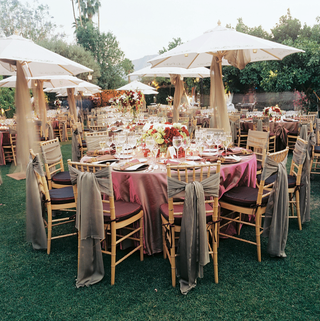 drapery-hangs-from-white-umbrellas-and-tied-to-reception-chairs