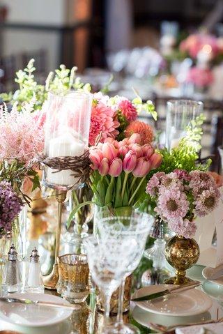 wedding reception centerpiece candleholder twig gold vase pink tulip and dahlia arrangements