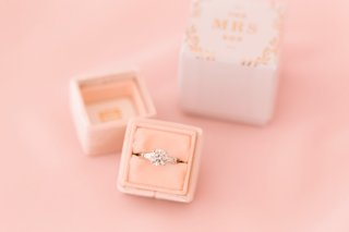 round-diamond-engagement-ring-with-tapered-baguette-side-stones-in-blush-velvet-mrs-box