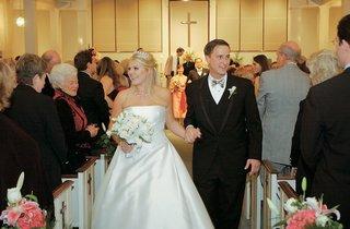 bride-and-groom-exit-wedding-as-newlyweds