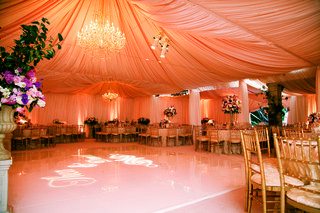 tented-reception-space-with-chandelier-and-monogram