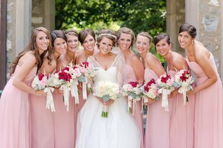 bride-with-bridesmaids-in-pink-gowns-and-summer-bouquets