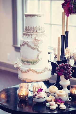 white-wedding-cake-with-golden-details-a-pastoral-portrait-and-flowers