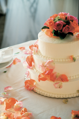 ivory-wedding-cake-topped-with-orange-roses