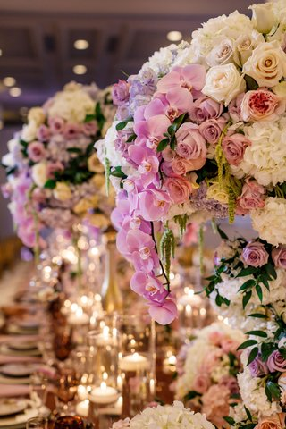 wedding-reception-tall-centerpiece-purple-orchid-white-rose-hydrangea-pink-rose-flowers-floating
