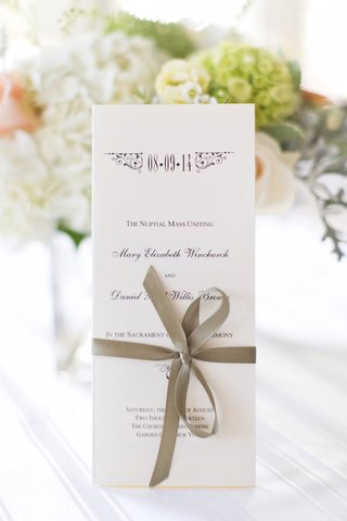 white-wedding-ceremony-program-with-tan-ribbon-bow