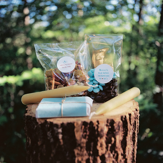 blue-and-brown-goodie-bag-items-on-tree-trunk